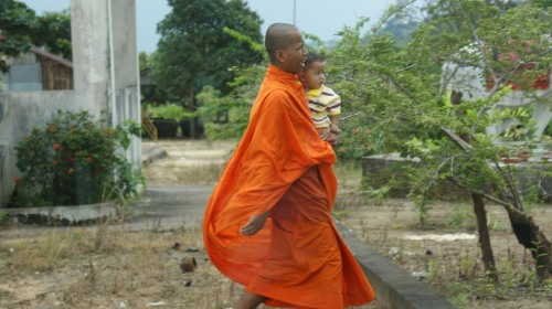 monk​ with children